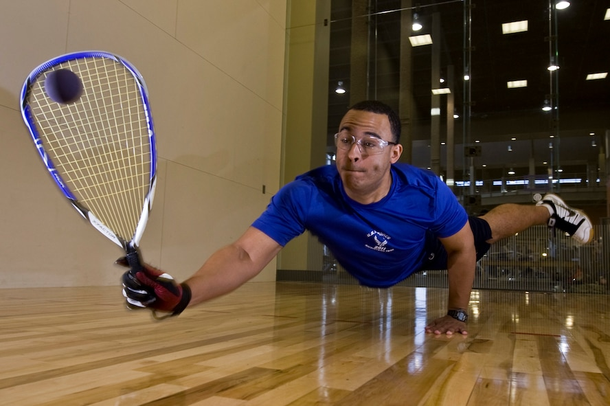 U.S. Air Force 2nd Lt. Maurice Mckoy, 99th Comptroller Squadron financial officer, dives to hit the raquetball May 17, 2012, at Nellis Air Force Base, Nev. McKoy has been playing competitive racquet ball for more than 12 years and was hand-picked by the chief of Air Force sports to represent the Air Force in the 45th National Racquetball Singles Championship in Fullerton, CA. (U.S. Air Force photo by Airman 1st Class Daniel Hughes)