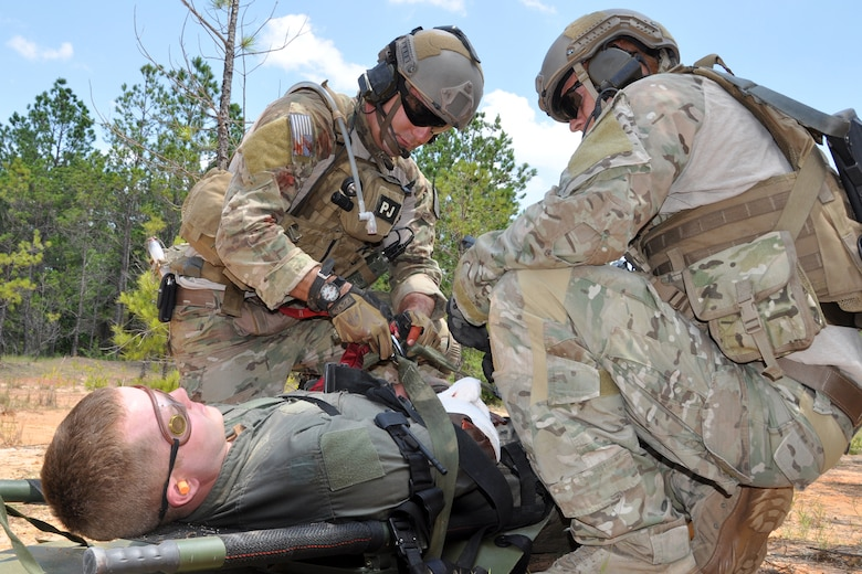 Pararescuemen assigned to the 920th Rescue Wing from Patrick Air Force Base, Fla., prepare an injured patient for hoisting into a medical helicopter during the mass casualty phase of the Patriot Saint exercise at Fort Polk, La., May 17, 2012. The goal of the exercise was to challenge pararescuemen to successfully execute combat search and rescue (CSAR) missions in real time while tactically solving enroute, fuel, communication, and OPFOR (Opposing Force) hurdles. (U.S. Air Force photo by Master Sgt. Jeff Walston/Released)