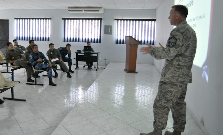 Senior Master Sgt. Richard Reed, 260th Air Traffic Control Squadron, briefs El Salvadoran Air Force air traffic controllers on how the Air National Guard trains their own air traffic controllers, as part of a week long Subject Matter Expert Exchange (SMEE) between the N.H. Air National Guard and the El Salvadoran Air Force, San Salvador, El Salvador, May 7 through 11, 2012.  This SMEE is part of the National Guard State Partnership Program. (Released/National Guard photo by Tech. Sgt. Aaron Vezeau)