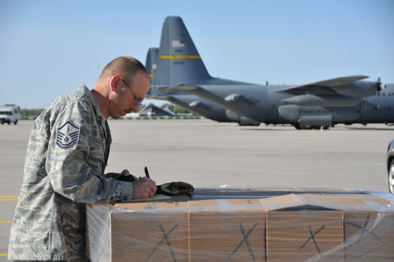 Master Sgt. Stephen Johnson, 153rd Logistics Readiness Squadron air transportation craftsman, prepares pallets of simulated vaccine as part of a Strategic National Stockpile exercise May 14, 2012, at the Wyoming Air National Guard base, Cheyenne, Wyo. Airmen assigned to the Wyoming Air National Guard worked with multiple state agencies to test abilities to receive, deliver and distribute medical supplies to various parts of the state. (U.S. Air Force photo by 1st Lt. Rusty Ridley)
