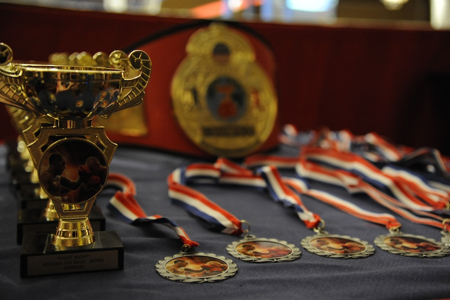 The collocated club hosted an amateur boxing event, sponsored by the 35th Force Support Squadron, at Misawa Air Base, Japan, May 18, 2012. Match winners won a trophy, while losing participants received a medallion for their efforts. A total of 38 participants fought at the event. (U.S. Air Force photo by Tech. Sgt. Marie Brown/Released)