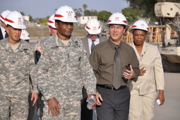 Lt. Gen. Thomas Bostick, U.S. Army Deputy Chief of Staff, G-1, is briefed by Resident Engineer Mike Siu on construction work by the Corps at Joint Forces Training Base Los Alamitos during a visit May 18. District Commander Col. Mark Toy (far left) and Military Programs Branch Chief Debra Ford (far right) look on.  Bostick is set to become the 53rd Chief of Engineers and commander of the U.S. Army Corps of Engineers May 22.
