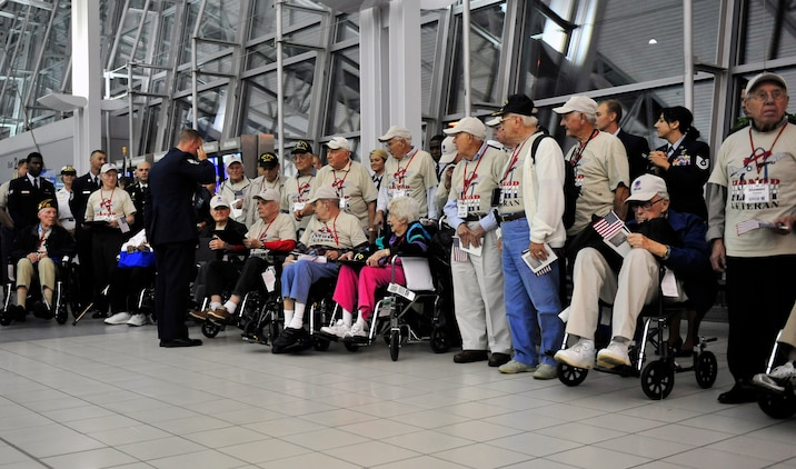 World War II veterans are presented a group photograph and letter of appreciation by active duty members assigned to Scott Air Force Base Ill., after their trip to the memorials in Washington D.C. May 21 sponsored by the Greater St Louis Honor Flight program.  Their family members and friends were waiting watching and cheering for them in the audience.  (U.S. Air Force photograph/ Staff Sgt. Stephenie Wade)