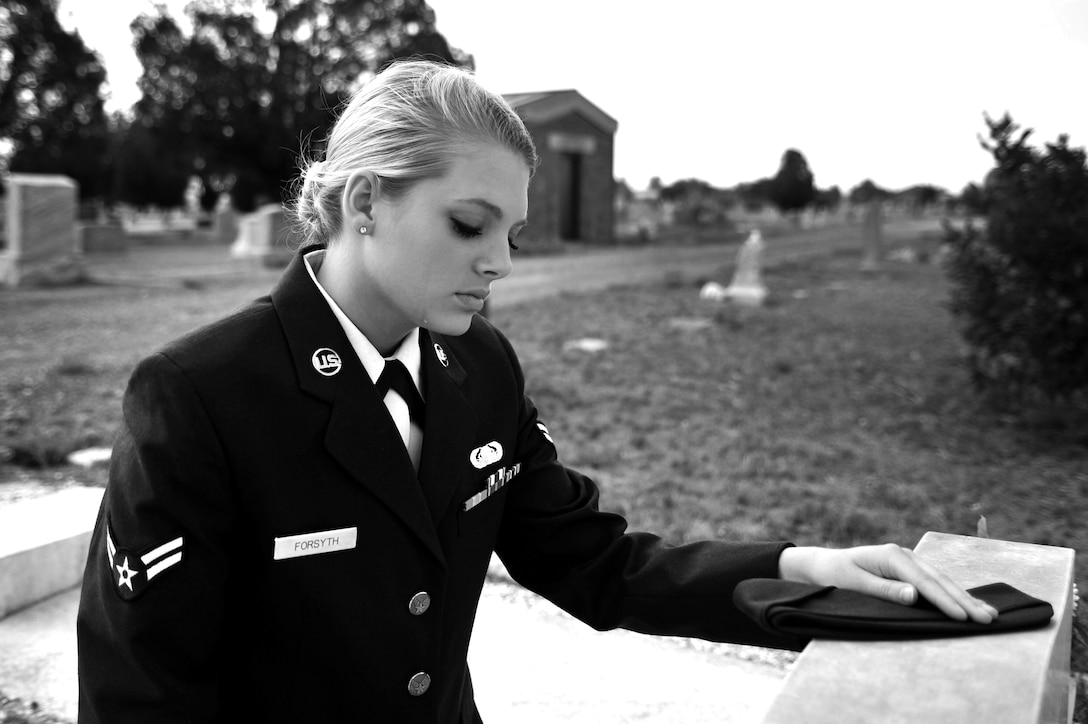 U.S. Air Force Airman 1st Class Daisey Forsyth, 27th Special Operations Communications Squadron knowledge operations manager, visits the tombstone of a fellow Airman who lost their life in an alcohol related incident near Cannon Air Force Base, May 20, 2011. Air Commandos are reminded of the risks involved with drinking and are urged to never let anyone drive while intoxicated. (U.S. Air Force photo illustration by Airman 1st Class Alexxis Pons Abascal)
