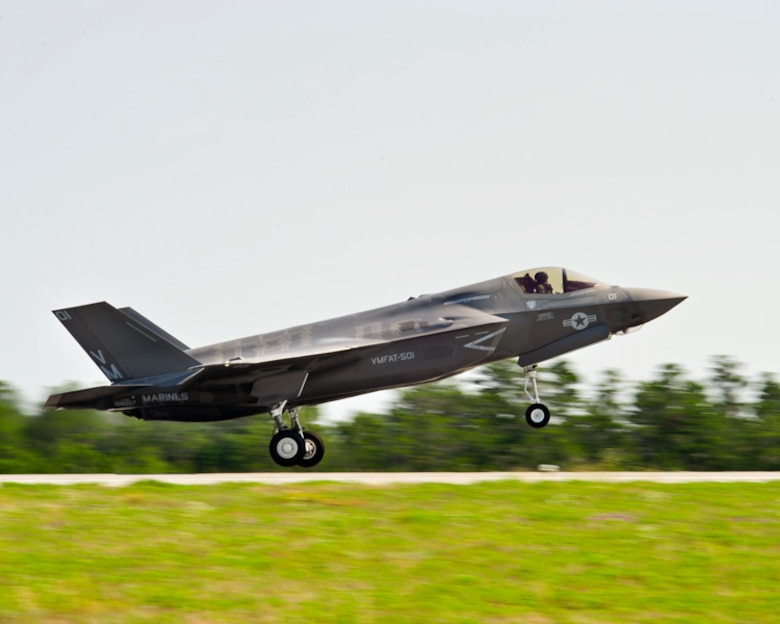 Marine Maj. Joseph Bachmann, a Marine Fighter Attack Training Squadron-501 pilot, takes off in his first F-35B sortie from Eglin Air Force Base, Fla., May 22. The goal for Marines was to start local area operations and conventional flights, beginning the process of gradually expanding the envelope to short takeoffs and vertical landings and more complex aerial training. The historic flight was airborne during the Marine Corps' 100th year of aviation, two months after 2nd Marine Aircraft Wing officially introduced the service's fifth generation fighter to the world at the 33rd Fighter Wing. (Lockheed Martin photo/David Drais)
