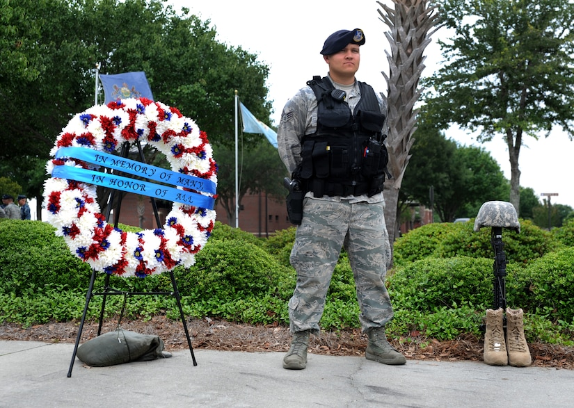 """Senior Airman Matthew Valverde, 628th Security Forces Squadron, stands at parade rest during the """"National Police Week"""" retreat ceremony May 18, 2012 at Joint Base Charleston, S.C. During National Police Week, Security Forces members honor law enforcement personnel who have fallen.  In 1962, President John F. Kennedy signed a proclamation which designated May 15th as Peace Officers Memorial Day and the week in which the date falls as Police Week. (U.S. Air Force photo/Airman 1st Class Ashlee Galloway)"""