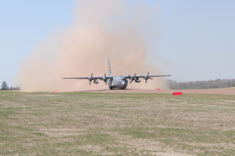 A Wyoming Air National Guard C-130 Hercules, assigned to the 153rd Airlift Wing, becomes the first to test the new Lt. Gen. Wright Tactical Airfield at the Camp Guernsey Joint Training Center's North Training Area, May 15, 2012. The airfield concept for Camp Guernsey was conceived 20 years ago and will provide aircrews real-world tactical training in coordination with ground combat forces. (Photo by Dewey Baars)