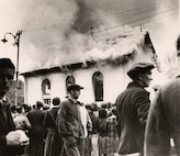 Local residents watch as a synagogue in Ober Ramstadt, Germany, burns during Kristallnacht.  Firefighters made no attempt to put out the blaze.  Photo from the Trudy Isenberg Collection, United States Holocaust Memorial Museum.
