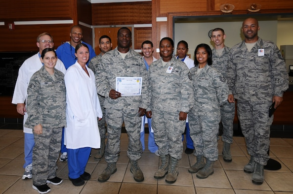 Staff Sgt. Jeremy Harris, 36th Medical Group dental hygienist, was awarded Andersen's Best May 11.  Andersen's Best is a recognition program which highlights a top performer from the 36th Wing. Each week, supervisors nominate a member of their team for outstanding performance and the wing commander presents the selected Airman/civilian with an award. To nominate your Airmen/civilian for Andersen's Best, contact your unit chief or superintendent explaining their accomplishments.  (U.S. Air Force photo by Senior Airman Carline Leslie/released)