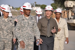 Lt. Gen. Thomas Bostick, U.S. Army Deputy Chief of Staff, G-1, is briefed by Resident Engineer Mike Siu on construction work by the U.S. Army Corps of Engineers Los Angeles District at Joint Forces Training Base Los Alamitos during a visit May 18. District Commander Col. Mark Toy (far left), and Military Program