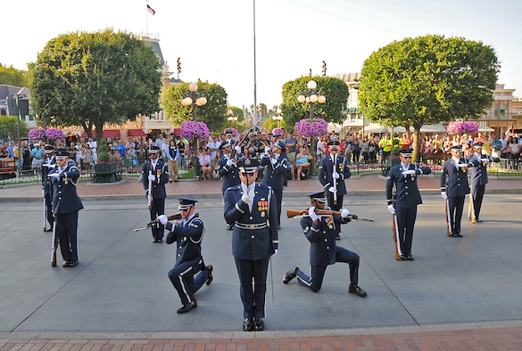 Members of the U.S. Air Force Honor Guard Drill Team perform for the crowd at Disneyland, May 20. (Photo by Joe Juarez)