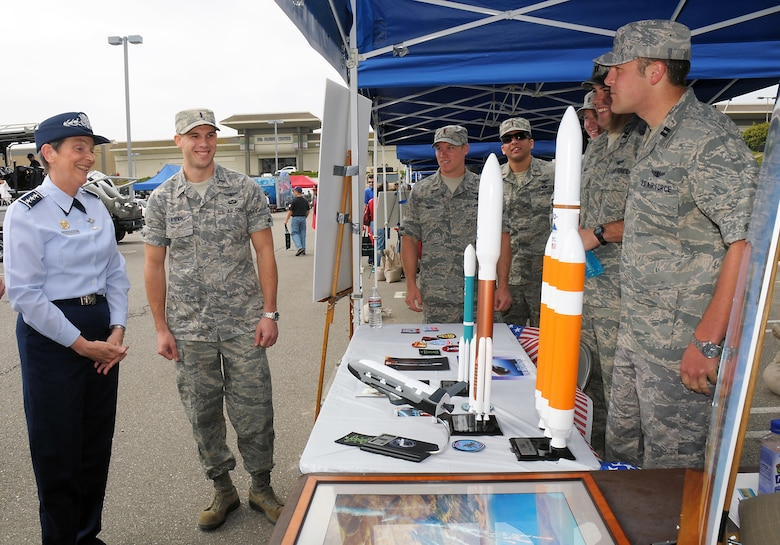 Lt. Gen. Ellen Pawlikowski, SMC commander, visits the Vandenberg AFB exhibit during Torrance's annual Armed Forces Day Celebration, May 19. Booths and static equipment displays showcasing all five services were open to the public at the Del Amo Mall during the entire weekend. (Photo by Joe Juarez)