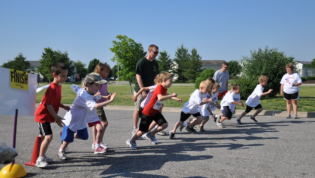 Children that participated in the America Kid's Run start the mile run at Scott May 19.  The run started at the Youth Center, went around Patriots Landing then ended at the Youth center. Children from the ages of 5 to 8 ran half a mile, 9 and 10 year olds ran 1 mile, and 11 and up ran two laps around Patriots Landing.(U.S. Air Force photo/Airman 1st Class)