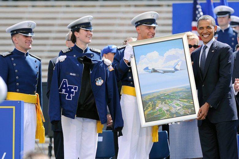 President Barack Obama receives a gift from senior ranking cadets after delivering the commencement address to the Air Force Academy's Class of 2012 at Falcon Stadium May 23, 2012. (U.S. Air Force photo/Mike Kaplan)