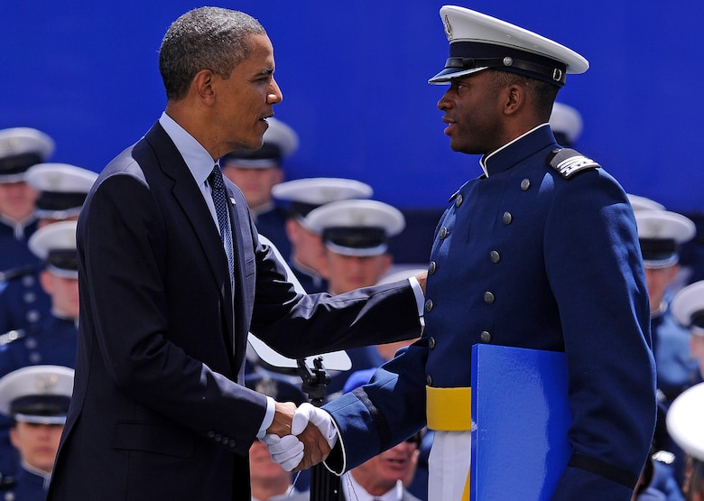 President Barack Obama congratulates Cadet 1st Class Timothy Jefferson on graduating from the Air Force Academy during the Academy's graduation ceremony in Falcon Stadium May 23, 2012. Jefferson was the starting quarterback for the Air Force Falcons football team. (U.S. Air Force photo/Mike Kaplan)