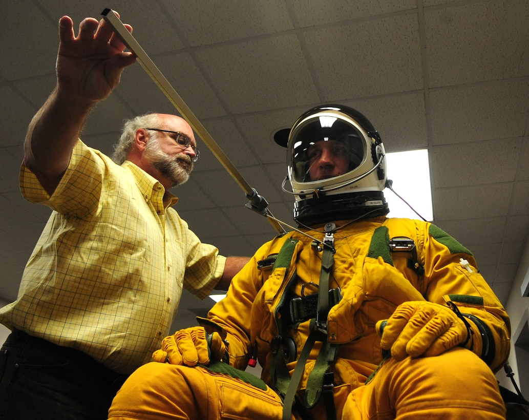 Dr. Gregory Zehner, 711th Human Performance Wing senior physical anthropologist, measures Airman 1st Class Alexander Scott, 9th Maintenance Squadron U-2 phase technician, while he wears a full pressure suit for a study at Beale Air Force Base, Calif., May 22. After baseline measurements, the suit was then inflated to simulate loss of cockpit cabin pressure at high altitudes. Experts, such as Zehner, from the Air Force Research Laboratory, Wright-Patterson Air Force Base, Ohio, visited here May 21-24 to investigate how big or small a pilot can be and still function in the cockpit of a U-2 Dragon Lady. (U.S. Air Force photo by Senior Airman Shawn Nickel)