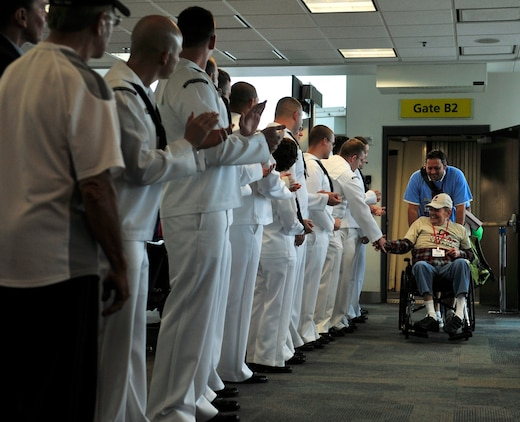 World War II veterans are welcomed to Washinton D.C. by active duty members May 21 before they board a bus to visit the memorials sponsored by the Greater St Louis Honor Flight program.  (U.S. Air Force photograph/ Staff Sgt. Stephenie Wade)
