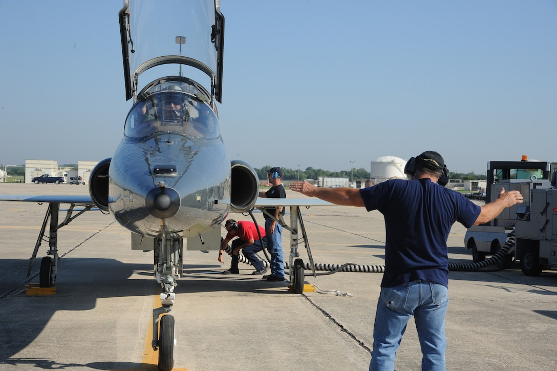 Keith Barnes (right), Jack Pagel (center) and Chuck Cornwall, 571st Aircraft Maintenance Squadron contractors, perform final checks to the T-38 Talon prior to Lt. Col. Ripley Woodard, 415th Flight Test Flight commander, taking off from Joint Base San Antonio-Randolph, Texas May 17. The T-38 is being returned to Sheppard Air Force Base, Texas, after being modified by the 571st here. (U.S. Air Force photo by Rich McFadden)