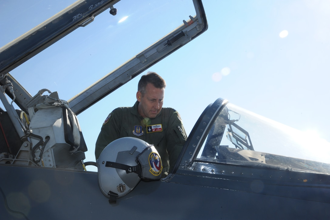 Lt. Col. Ripley Woodard, 415th Flight Test Flight commander, climbs into a T-38 Talon May 17 on Joint Base San Antonio-Randolph, Texas. The T-38 is being returned to Sheppard Air Force Base, Texas after being modified by the 571st Aircraft Maintenance Squadron here . (U.S. Air Force photo by Rich McFadden)