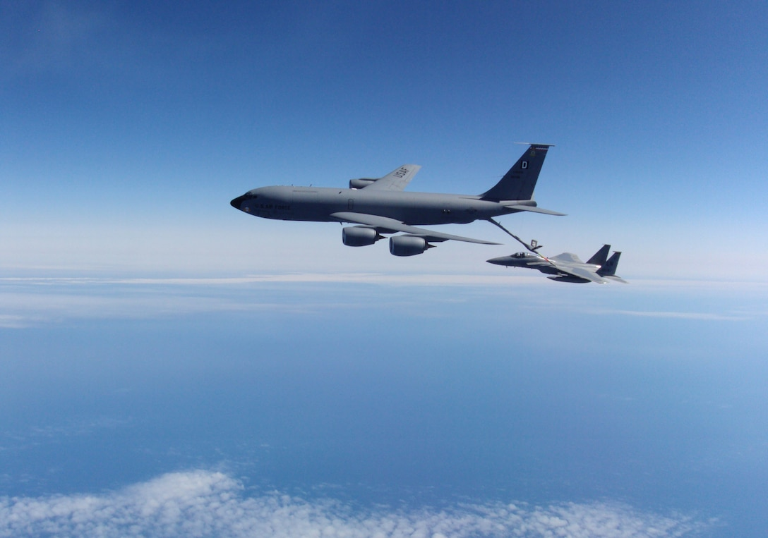 KEFLAVIK, Iceland -- A KC-135 Stratotanker, deployed from Royal Air Force Mildenhall, England, refuels an F-15C Eagle, deployed from RAF Lakenheath, England, while flying an alert mission exercise with the 493rd Expeditionary Fighter Squadron in Iceland May 22, 2012.  The squadron, made up of both U.S. Air Force and NATO personnel, is fulfilling an air policing mission that assists in assuring Iceland's air sovereignty. (Courtesy photo)