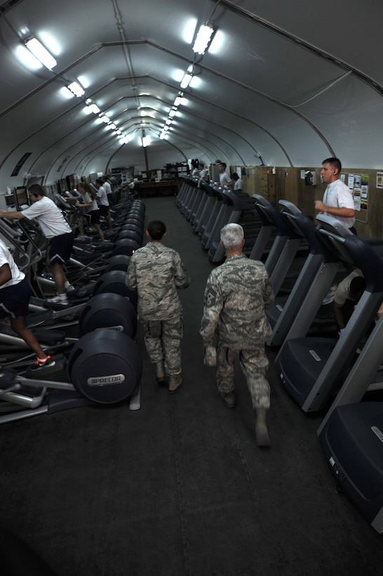 SOUTHWEST ASIA -- Chief Master Sgt. Robert Sealey gets a tour of fitness facilities from Master Sgt. Lauralee Okoniewski May 22, 2012. Sealey, the U.S. Air Forces Central command chief master sergeant, spoke with several groups of Airmen during his two-day visit to the 380th Air Expeditionary Wing. Okoniewski is a Walnut Ridge, Ark., native deployed from Scott Air Force Base, Ill. (U.S. Air Force photo/Staff Sgt. J.G. Buzanowski)