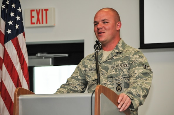 National Guard Staff Sgt. Russell Logan from the 164th Security Forces Squadron, Tennessee Air National Guard, speaks to Airmen of the 165th Airlift Wing at the Georgia Air National Guard base at Savannah/Hilton Head International Airport in Savannah, Ga., May 22, 2012. Logan's left leg was amputated due to wounds resulting from a detonated landmine at Bagram Airfield in Afghanistan. (National Guard photo by Tech. Sgt. Charles Delano/Released)