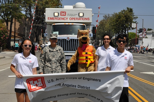 The District's new Emergency Command and Control Vehicle, operated by Alex Watt, made its debut appearance at the City of Torrance's 53rd Annual Armed Forces Day Celebration May 19 and was led by the District's commander, Col. Mark Toy, wife May, daughter Kayla and son Brandon.  The Toys carried the District's banner, followed by the ECCV, Fany Anderson of the District's safety office and Bobber the Water Safety Dog, along the two-mile parade route.