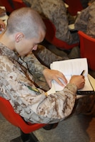 Company G recruits take notes during a Marine Corps history class May 11 aboard Marine Corps Recruit Depot. It is important recruits know the history of the Marine Corps so they understand the traditions. Many recruits come to the depot not knowing any of the knowledge they recieve during these classes.