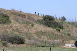 Recruits of Company D hike the hills of Edson Range, Marine Corps Base Camp Pendleton, Calif. while they work on their land navigation skills May 16. During field week recruits get a feel for working in the field by sleeping outside and eating meals-ready-to-eat.