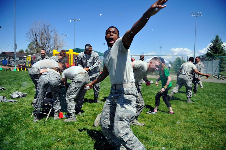 """BUCKLEY AIR FORCE BASE, Colo. -- 460th Space Wing members cool off during a free-for-all, water balloon fight May 24, 2012. Celebrating an """"Excellent"""" rating for the recent Operational Readiness Inspection, the 460th SW threw a celebration at the softball fields.   (U.S. Air Force photo by Staff Sgt. Kathrine McDowell)"""