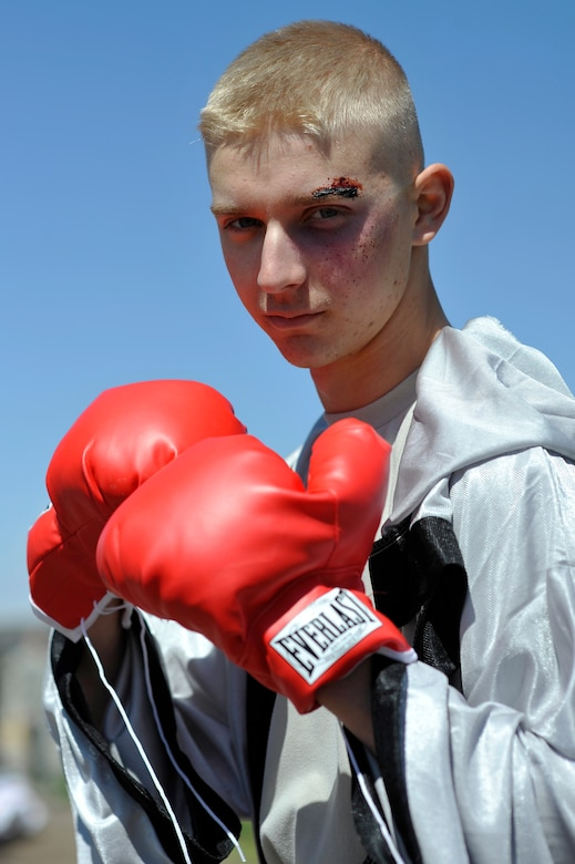 BUCKLEY AIR FORCE BASE, Colo. -- Airman 1st Class Dylan Williams, 460th Space Communications Squadron, poses as a boxer here May 24, 2012. The costume was part of the festivities at Team Buckley's Post-Operational Readiness Inspection Party. (U.S. Air Force photo by Staff Sgt. Kathrine McDowell)