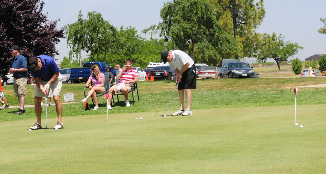 Members of Team Beale practice putting during the Beale Liaison Committee golf tournament at the Coyote Run Golf Course here May 18. Members of the winning group included: Joey Brown, Chris White. Donald Payne and Shawn O'leary. (U.S. Air Force photo by Senior Airman Allen Pollard/Released)