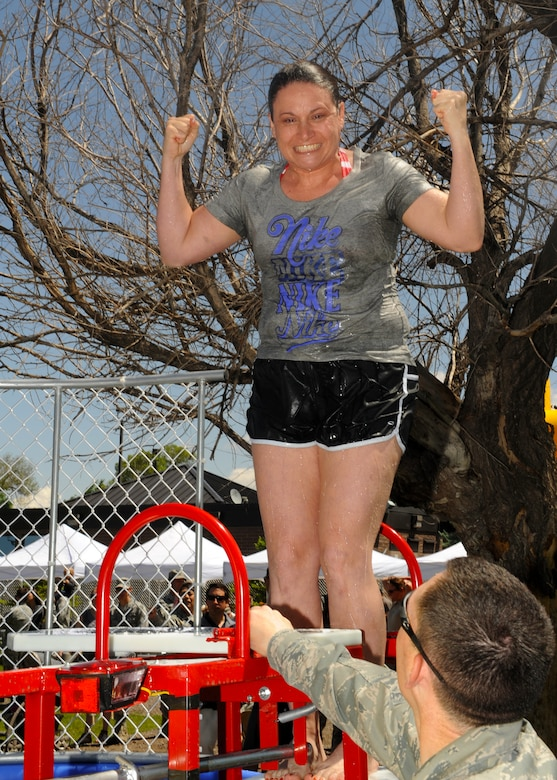 BUCKLEY AIR FORCE BASE, Colo. -- Master Sgt. Brandy Sharp, 460th Mission Support Group, shows her excitement after taking a dip in the dunk tank May 24, 2012. For passing the Operational Readiness and Unit Compliance Inspections, Team Buckley celebrated with food, games and the opportunity to dunk your favorite commander or first sergeant. (U.S. Air Force photo by Senior Airman Marcy Glass)
