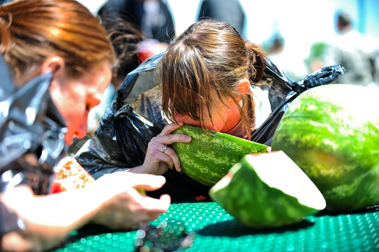BUCKLEY AIR FORCE BASE, Colo. -- Airman 1st Class Danielle Keister,460th Security Forces Squadron pass and ID technician, devours a watermelon during a watermelon eating contest May 24, 2012. Members of Team Buckley participated in a day of activities celebrating their excellent rating during a recent Operational Readiness Inspection. (U.S. Air Force Photo/ Senior Airman Paul Labbe)