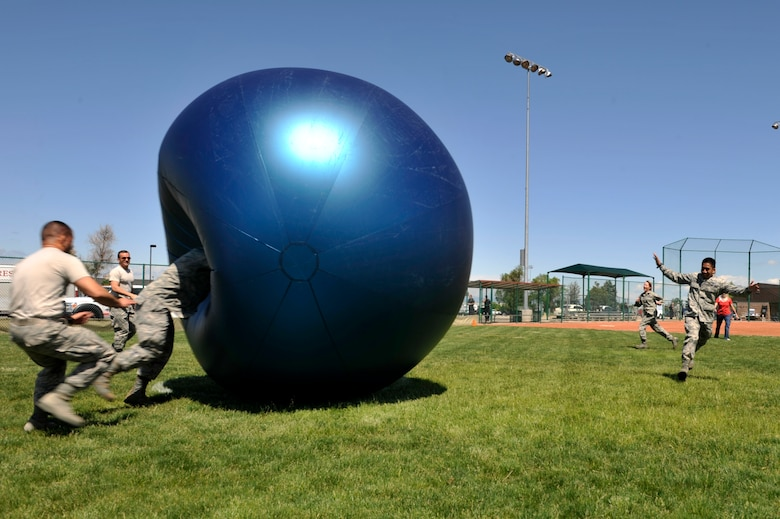 """BUCKLEY AIR FORCE BACE, Colo. – Team Buckley members participate in """"Power Ball"""", May 24, 2012.  """"Power Ball"""" was one of the many activities held at the post-Operational Readiness Inspection celebration. (U.S. Air Force photo by Airman 1st Class Riley Johnson)"""