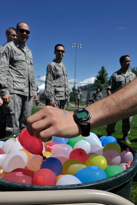 """BUCKLEY AIR FORCE BACE, Colo. – Shown are some of the hundreds of water balloons thrown during a free-for-all here May 24, 2012. Team Buckley gathered at the softball fields in celebration of earning an """"Excellent"""" for the recent Operational Readiness Inspection.  (U.S. Air Force photo by Airman 1st Class Riley Johnson)"""