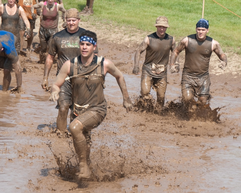 Members of the 109th Aeromedical Evacuation Squadron, Minnesota Air National Guard team plow through the Tough Mudder obstacle course in Somerset, Wis. on May 19, 2012.  About a dozen Aeromeds made up one team and there were at least a dozen others from the 133rd Airlift Wing getting muddy for exercise, camaraderie, and to help raise money for the Wounded Warrior project.  U.S. Air Force Photo by Staff Sgt. Jonathan Young