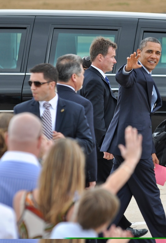 BUCKLEY AIR FORCE BASE, Colo. -- President Barack Obama waves goodbye to the crowd as he gets ready to head downtown after landing here May 23, 2012. Obama was escorted to downtown Denver where he made a public appearance and left Buckley a short time afterward. (U.S. Air Force photo by Senior Airman Christopher Gross)