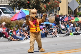 CALIFORNIA — Bobber the Water Safety Dog waves at spectators along the two-mile parade route during the City of Torrance Armed Forces Day parade, May 19, 2012.