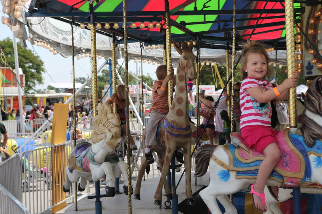 A merry-go-round keeps a group of children happily occupied during Maynia, the annual carnival-themed celebration hosted by Marine Corps Community Services, at W.P.T. Hill Field aboard Marine Corps Base Camp Lejeune Saturday.
