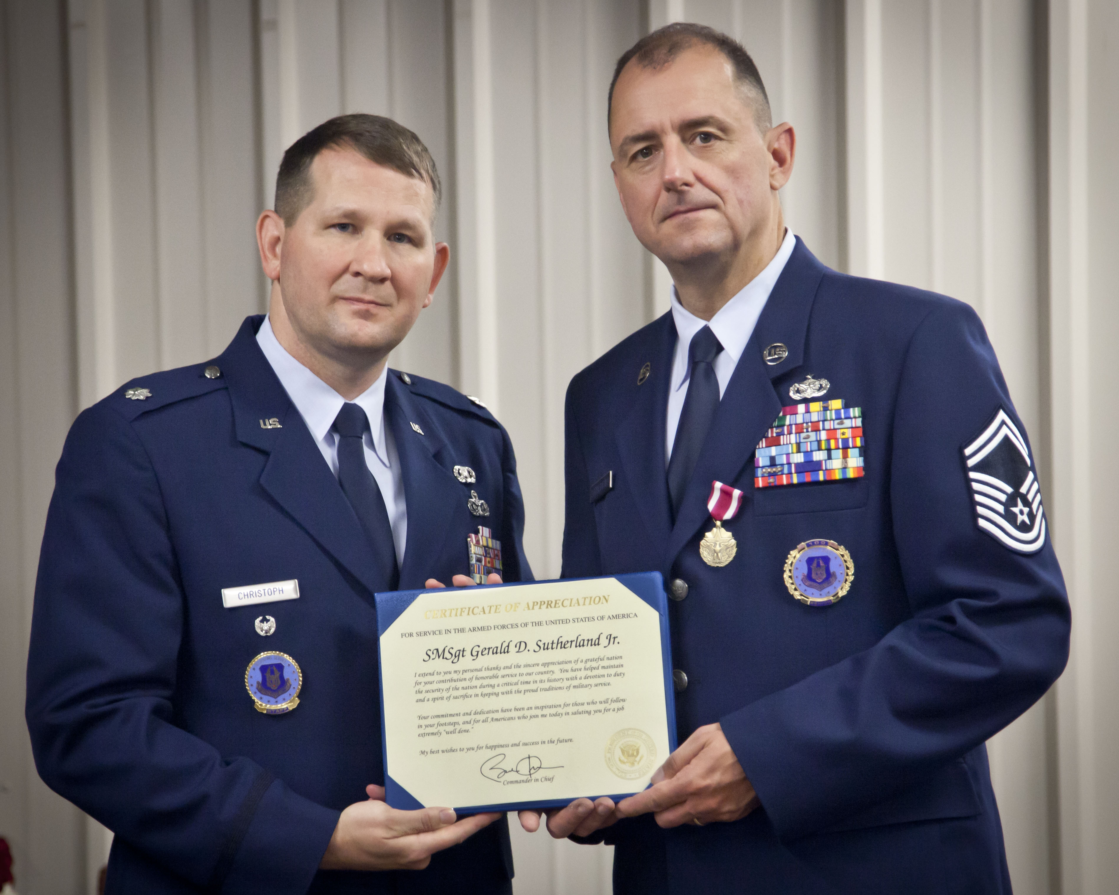 Photos lt col michael christoph presents senior master sgt gerald sutherland with his meritorious yadclub Gallery