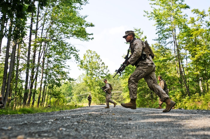 Second Lt. Jerry Hauburger, a rifleman with 2nd Platoon, 4th Squad, Charlie Company, The Basic School, sprints across a road during a foot patrol exercise at Landing Zone 7, May 25. More than 200 Marines with Charlie Co.,TBS, completed their final preparations for their convoy exercise.