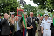 Col. Kenneth M. DeTreux (center), commanding officer, Special Purpose Marine-Air Ground Task Force - New York, and other civic leaders rededicated the Col. Donald Cook Park in Brooklyn, New York, May 24. Cook joined the Marine Corps in 1957. During the Vietnam War, Cook volunteered to lead a nine-manned reconnaissance mission to search for a downed helicopter. Cook was shot and captured during this mission. Throughout his time as a prisoner of war, Cook refused to give information to his captors regarding the U.S. military. For this, he was given less food and often placed in solitary confinement. Even under such conditions, Cook gave most of his food away to other prisoners who he felt were in more need. He was posthumously awarded the Medal of Honor. Cook remains the only Marine to be awarded the Medal of Honor while he was a POW. Fleet Week is an opportunity for Marines, sailors, and coast guardsmen to show the people of New York what the Navy, Marine and Coast Guard team is, what they do, and how committed it is to serving this country. Twenty-one U.S. and coalition ships and more than 6,000 troops will participate in the 25th anniversary of Fleet Week New York, a celebration of the Bicentennial of the War of 1812, May 23-30. (Official Marine Corps photo by Cpl. Martin Egnash)