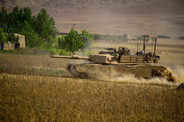 An M1A1 Abrams Main Battle Tank, with Alpha Company, 1st Tank Battalion, moves into position during a firefight in the town of Zamindawar, May 27, 2012. The tanks support Marines with 2nd Battalion, 5th Marine Regiment during Operation Jaws.