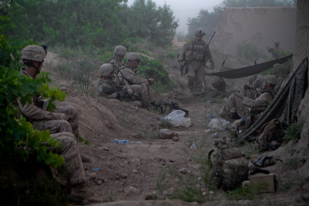 Marines with 2nd Battalion, 5th Marine Regiment, take a breather as the smoke clears from a firefight, May 28, 2012. The Marines encountered small arms fire, mortars and rocket-propelled grenades, during their clearing operation through Zamindawar.