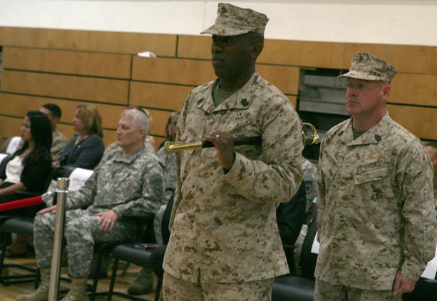 """Sgt. Maj. Ronald L. Green , outgoing sergeant major, stands in front, ready to conduct the """"passing of the sword,"""" a Marine Corps tradition that signifies the transfer of responsibility, to Sgt. Maj. James J. McCook, the incoming sergeant major for U.S. Marine Forces Europe and Africa. The two commands welcomed their new senior enlisted leader, McCook, as they bid farewell to Green, May 29, during a relief-and-appointment ceremony at U.S. Army Garrison Stuttgart.::r::::n::::r::::n::"""