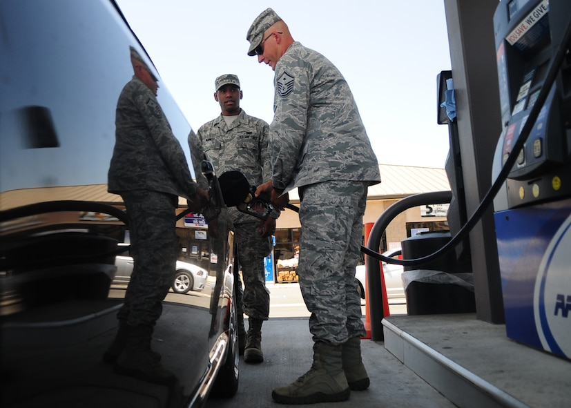 Master Sgt. Chad Hepner, 9th Medical Group first sergeant, buys fuel for Airman 1st Class Ireton Bennett, 9th Communications Squadron, as a random act of kindness May 24, 2012 at the housing shoppette, Beale Air Force Base, Calif. Beale's first sergeants purchased $2,000 in fuel for Airmen E-1 through E-5 and washed windshield during the Operation Warm Heart event. (U.S. Air Force photo by Senior Airman Shawn Nickel)
