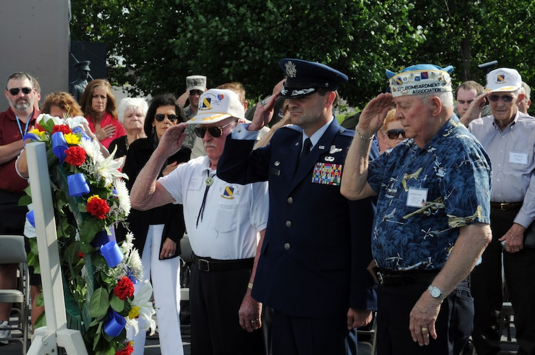 Col. Ken Rizer, 11th Wing/Joint Base Andrews Commander along with Bud Jung (left) and Neil Siebenbruner (Right) take part in a wreath laying ceremony at the Air Force Memorial, May 17. The ceremony was held to pay tribute the members of the 11th Bombardment Group that lost their lives in the Pacific during World War II. (U.S. Air Force photo/Airman 1st Class Aaron Stout)