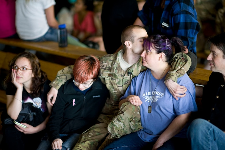 JOINT BASE ELMENDORF-RICHARDSON, Alaska - Airman 1st Class Steven Wahl, a helicopter crew chief with the Alaska Air National Guard's 176th Aircraft Maintenance Squadron, kisses his mom, Kim, and wraps his arm around his sister, Karissa, as he prepares to leave for Afghanistan May 28, 2012. Wahl is flanked by his father, Nick, and his cousin, Tiffany Stroman. More than 180 members of the Alaska Air National Guard's 176th Wing are deploying for about 120 days in support of Operation Enduring Freedom. (National Guard photo by Master Sgt. Shannon Oleson)