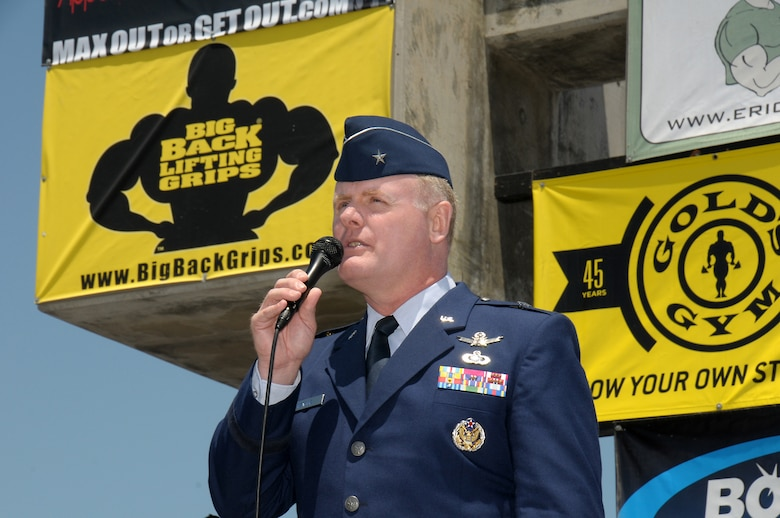 Brigadier Gen. Roger Teague, Space and Missile Systems Center vice commander, speaks during the Muscle Beach Classic's military tribute, May 28. (Photo by Joe Juarez)